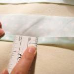9. Reißverschlussteile nach innen bügeln