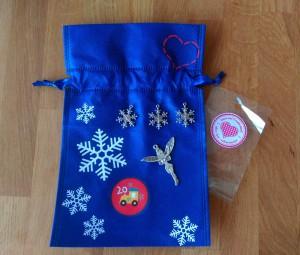 Im 20.Säckchen: Taschenbaumler, drei Schneeflocken und eine Fee